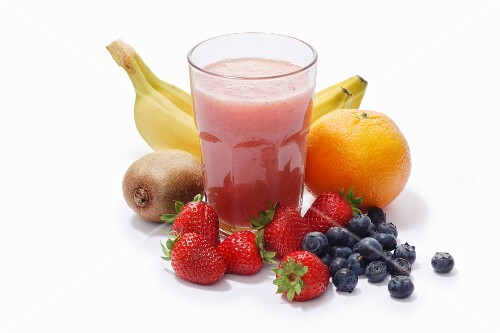 A banana, strawberry, blueberry, kiwi and grapefruit smoothie