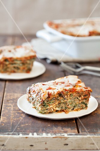 Serving of Spinach and Lasagna on a Plate