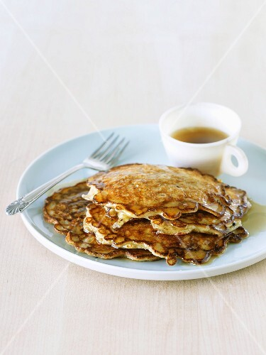 Stack of Oatmeal Pancakes with Maple Syrup on a Plate with a Fork