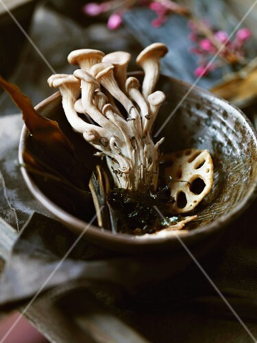 Enoki mushrooms and lotus roots in a bowl