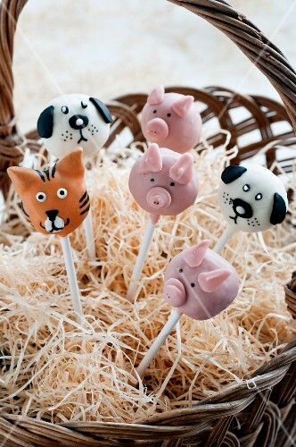Cake Pops decorated as various animals in a basket