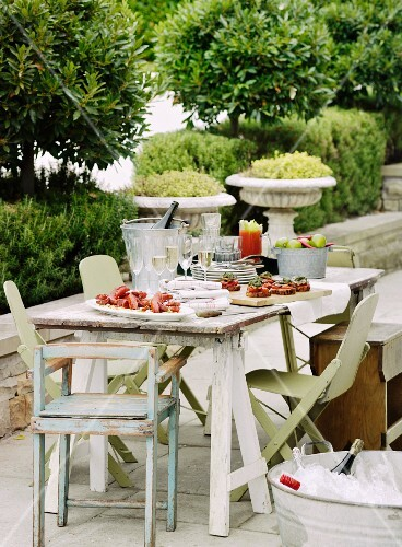 Table set outside with nibbles and drinks