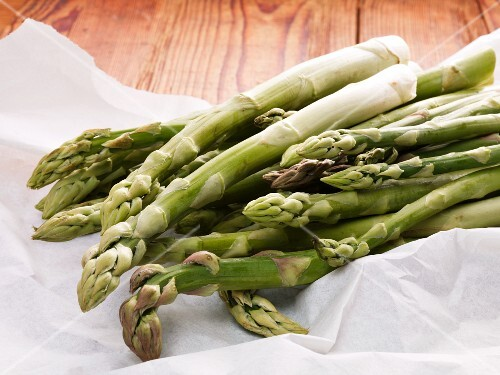 Fresh green asparagus on a piece of paper