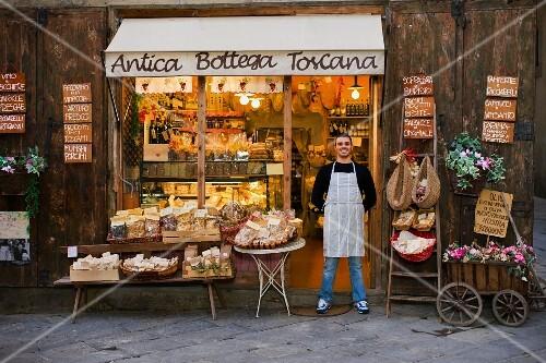 Owner standing in front of deli
