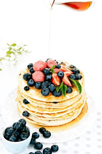 Blueberry pancakes with strawberry sorbet and maple syrup