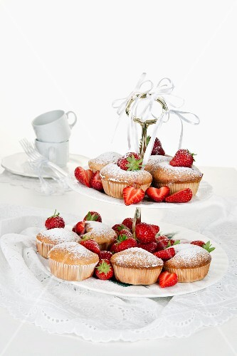 Strawberry and sour cream muffins on a cake stand
