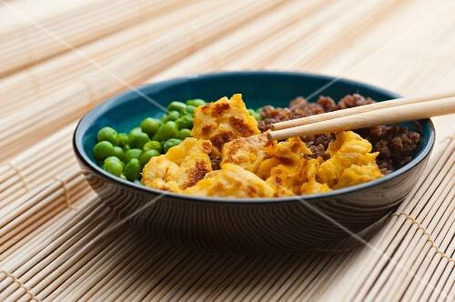 Sanshokudon (rice dish with peas, minced meat and scrambeled egg, Japan)