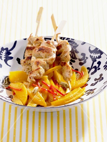 Chicken kebabs with mango salad and cardamom
