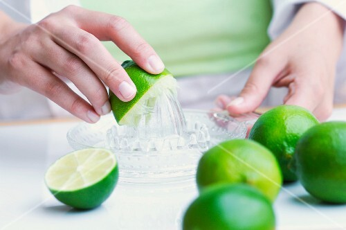Limes being juiced