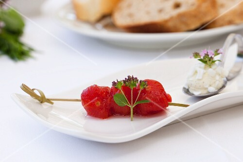 Skinned cocktail tomatoes on stick