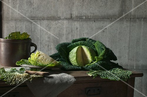 A sliced savoy cabbage on a wooden table