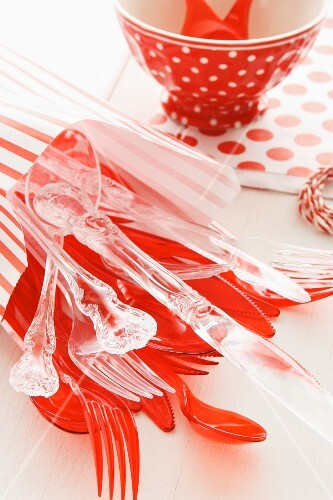 Red and transparent plastic cutlery for a child's birthday party