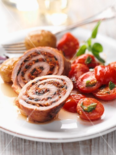 Stuffed veal roulade with a warm tomato salad