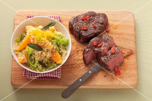 Beef steak and couscous with orange