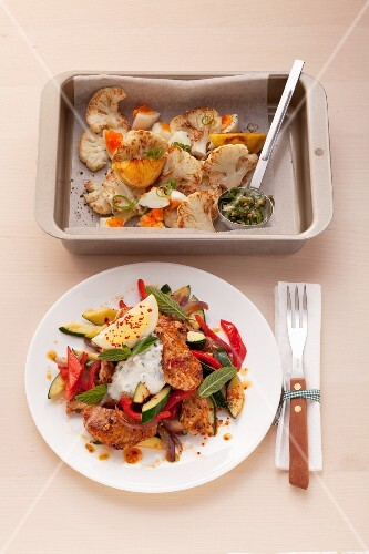 Roasted cauliflower with diced egg and turkey with vegetables