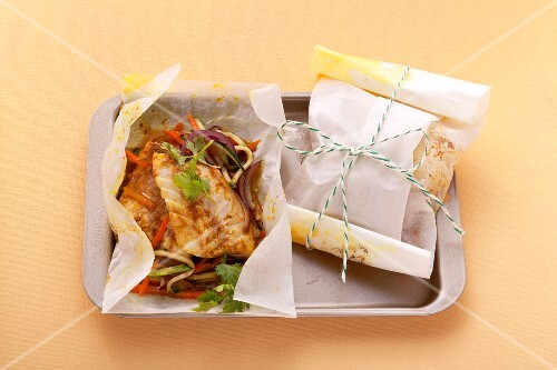 Rose fish with vegetables baked in parchment paper