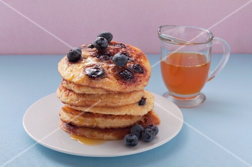 Pancakes with blueberries and orange syrup