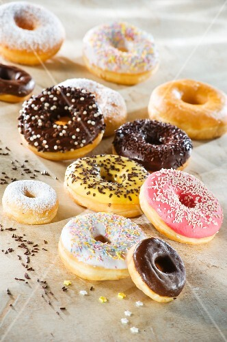 Doughnuts with colourful glaze and sugar sprinkles