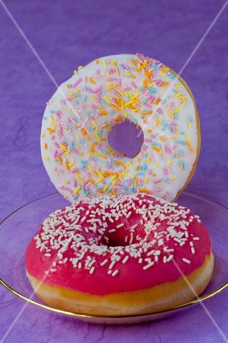 Doughnuts with icing sugar and a raspberry glaze
