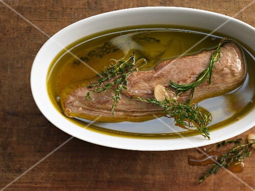 Pork fillet confit with oil and herbs