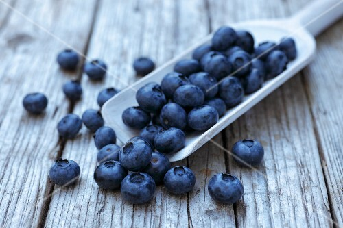 Blueberries on a wooden scoop
