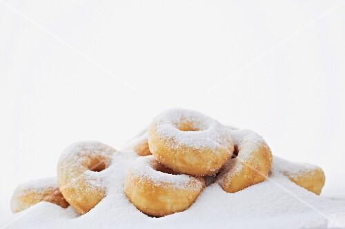 Doughnuts in a pile of sugar