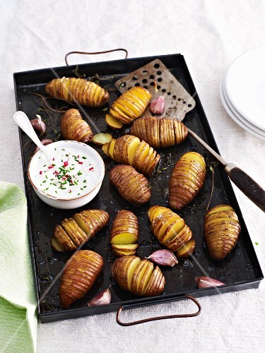 Hasselback potatoes with chive quark