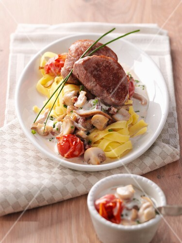 Pork medallions on a bed of tagliatelle with a vegetable sauce