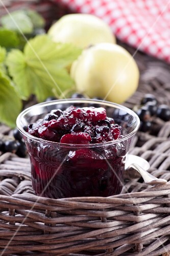 Blackcurrant and apple jam in a glass jar