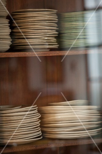 Stacked plates in the kitchen cupboard