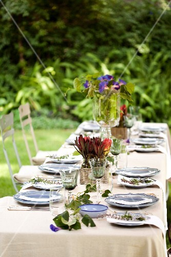 A table laid for a meal in the garden