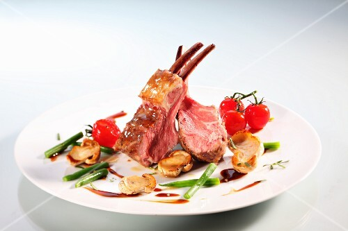 Lamb crown with mushrooms, beans and cherry tomatoes