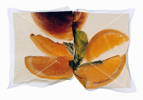 Orange wedges, oranges and mint leaves on a photo print