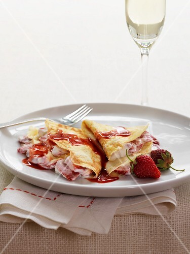 Strawberry crepes with strawberry syrup