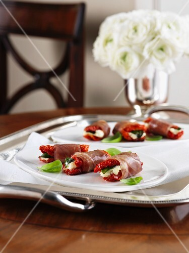 Prosciutto rolls with dried tomatoes and goat's cheese for Christmas
