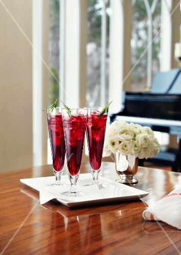 A welcome cocktail on a table in front of a piano