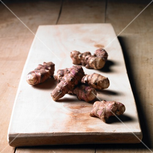 Jerusalem artichokes on a wooden board