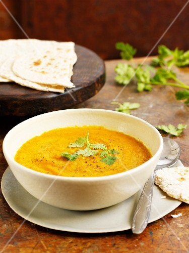 Carrot and curry soup with unleavened bread