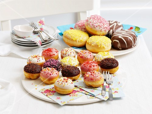 Doughnuts with icing and sugar sprinkles