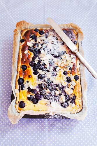 Blueberry cake with slivered almonds and icing sugar