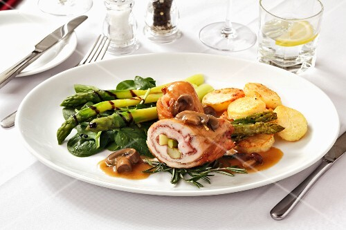Stuffed chicken breast with asparagus and mushroom sauce