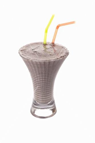 A milkshake with two straws