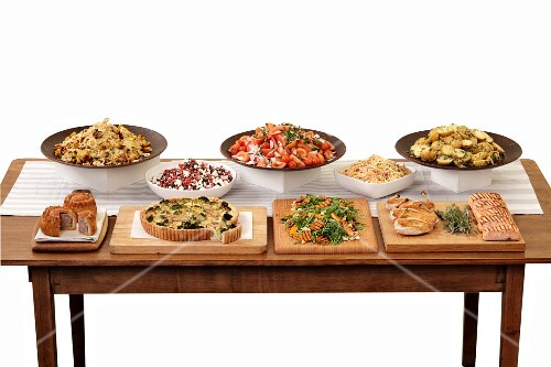 Chicken, salmon, quiche and side dishes on a buffet
