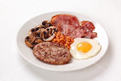 English breakfast with baked beans, bacon and fried egg