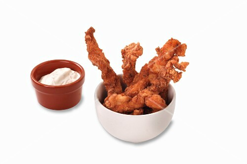 Fried chicken strips with a sour cream dip