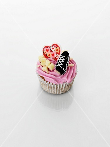 A cupcake with strawberry cream for Valentine's Day