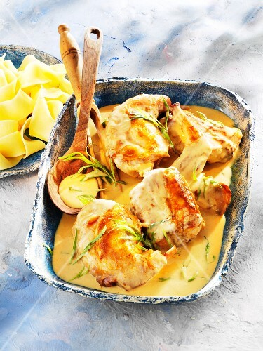 Braised rabbit in a tarragon and mustard sauce with pasta