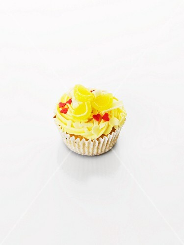A cupcake decorated with lemon bonbon and sugar hearts