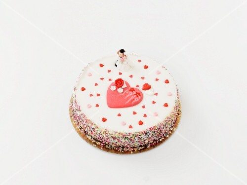 A wedding cake decorated hearts