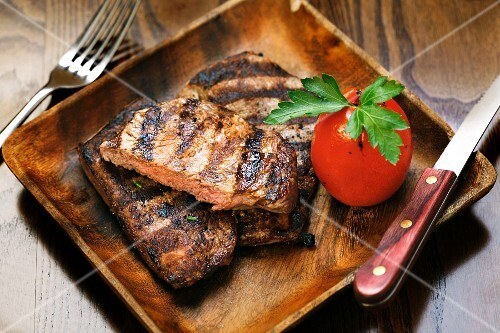 Grilled steak with a tomato
